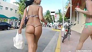 Candid - foxy latin sweetheart in thong bikini walking do...