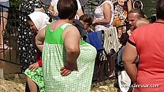 Almost in nature's garb chicks bathing in transparent shirts