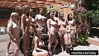 Naked angels posing at a nudist club
