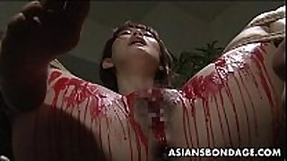 Asian sweetheart get her privates overspread in wax.