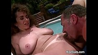 Sexy dark brown milf with large hooters