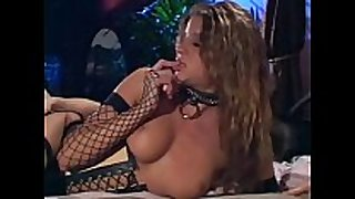 Sex in a corset dark boots and fishnet nylons