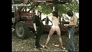 Naked thrall with great body is spanked on her a...