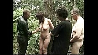 Milf thrall fastened to a tree acquires spanked on her l...