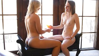 Young babe rides dildo while her girlfriend records it on cam