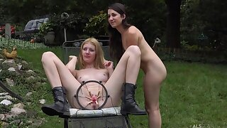 Two beautiful young babes with natural tits having fun outdoors